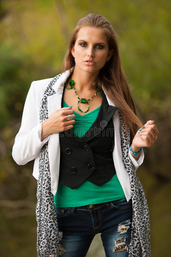 Blog style beautiful brunette woman in fashionable dress posing royalty free stock photos