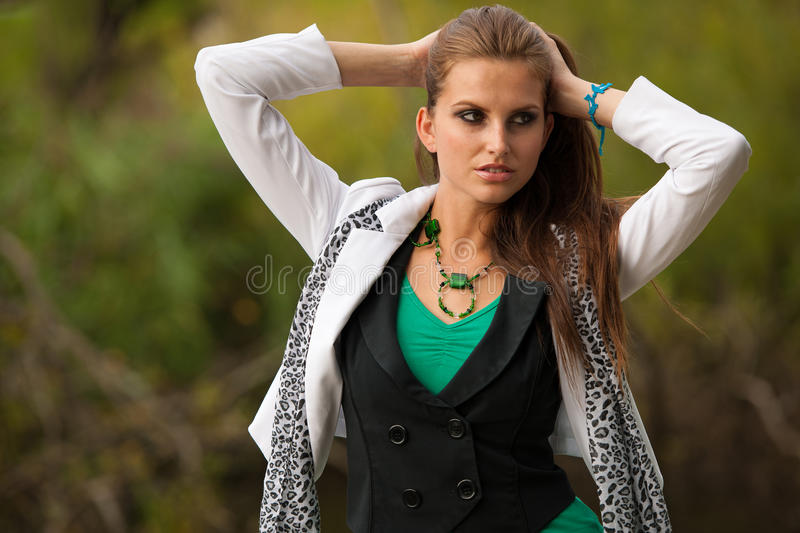 Blog style beautiful brunette woman in fashionable dress posing stock photos