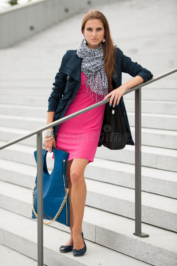 Blog style fashionable woman on stairs posing royalty free stock photo