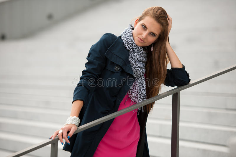 Blog style fashionable woman on stairs posing stock images
