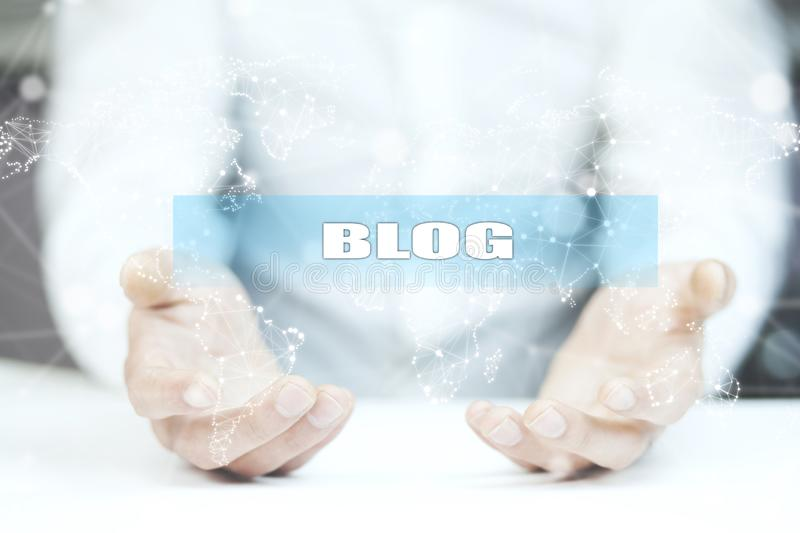 Blog text on screen on man hand.  royalty free stock image