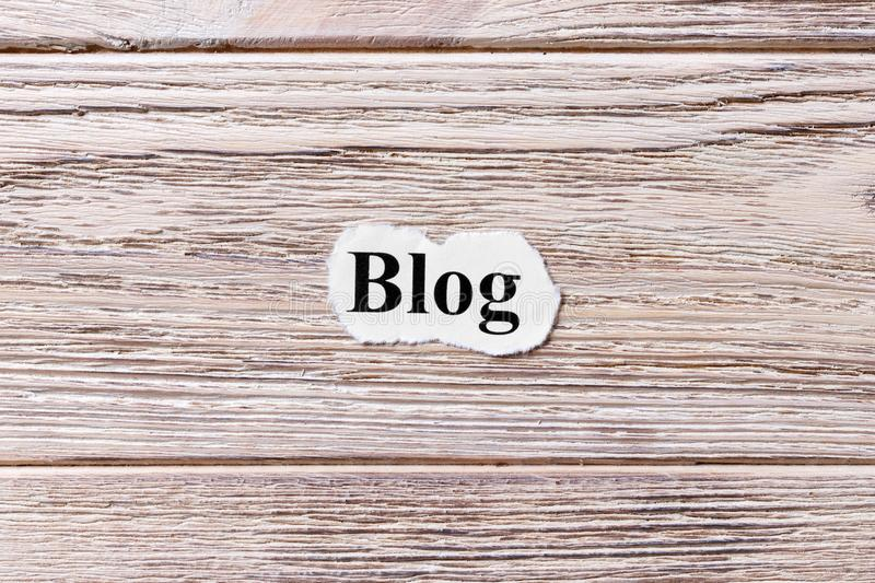 BLOG of the word on paper. concept. Words of BLOG on a wooden background royalty free stock photography