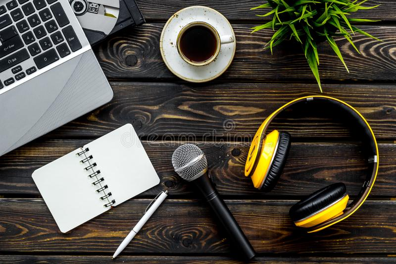 Blogger, journalist or musician office desk with computer keyboard, notebook, microphone and headphones on wooden royalty free stock images