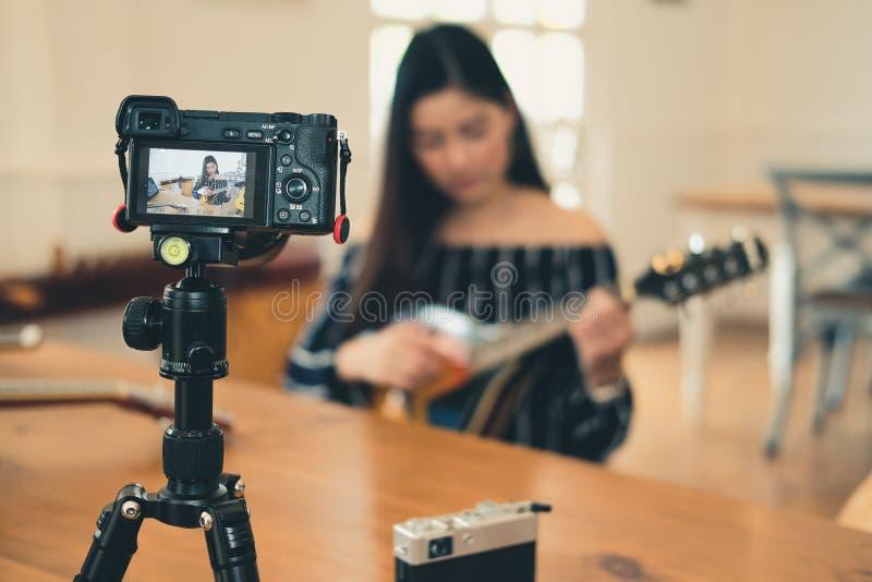Blogger live broadcasting music instrument tutorial on social media. vlogger recording online vlog video stock photo