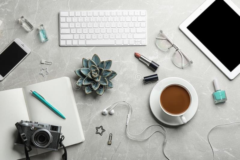 Blogger`s workplace with coffee, tablet and different stuff on table, royalty free stock image