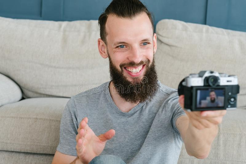 Blogger video streaming live man camera technology. Blogger streaming live video. bearded hipster man communicating with subscribers through camera. new modern royalty free stock image