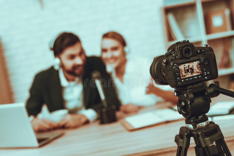 Bloggers makes a video about a business stock photos