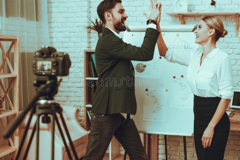 Bloggers makes a video about a business royalty free stock photos