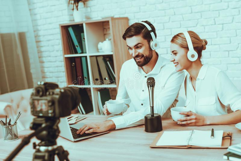 Bloggers makes a video with a microphone stock photography