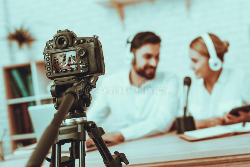 Bloggers makes a video with a microphone royalty free stock photography