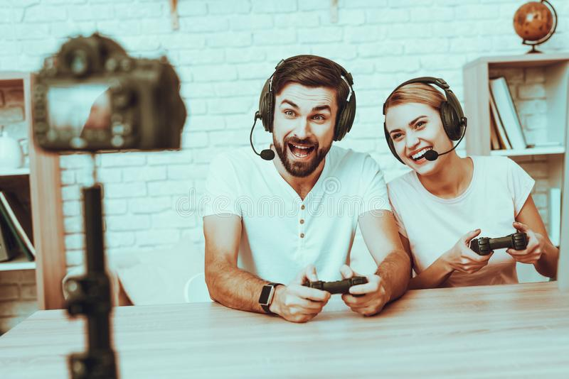 Bloggers playing a video game on console stock photos