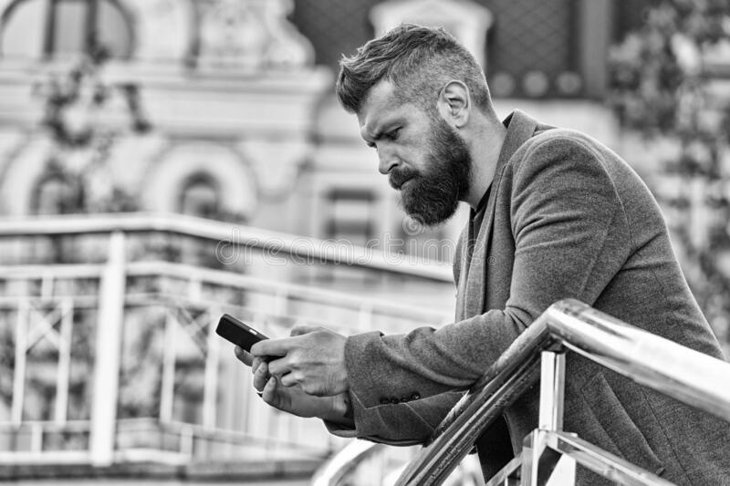 Blogging for business. Man blogger outdoor. Businessman keep business blog. Bearded man read blog post. Follow marketing stock photography
