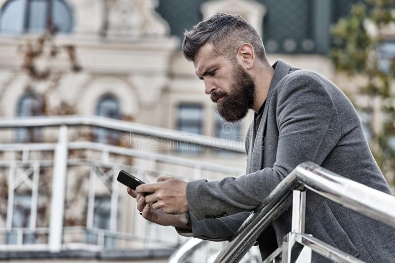 Blogging for business. Man blogger outdoor. Businessman keep business blog. Bearded man read blog post. Follow marketing stock images