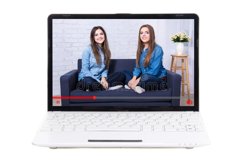 Blogging concept - beautiful girls bloggers on laptop screen stock photography