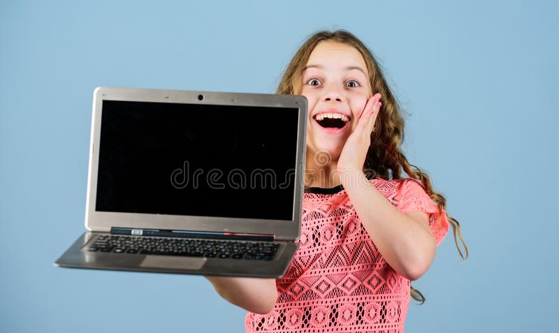Blogging concept. Child little girl with laptop computer. Little child using pc. Digital technology. Kid study with. Laptop. Surfing internet. Develop own blog royalty free stock photography