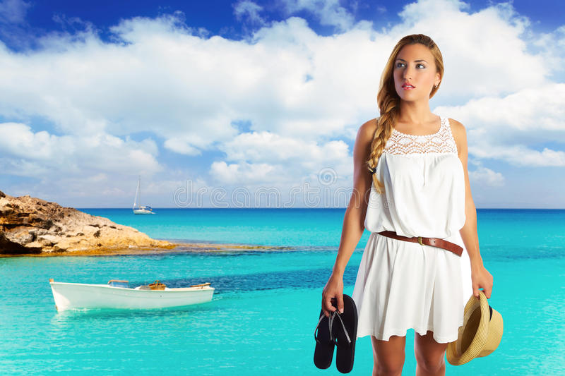 Bloind tourist in a beach wih basket and flip flops. At Formentera photomount stock photography