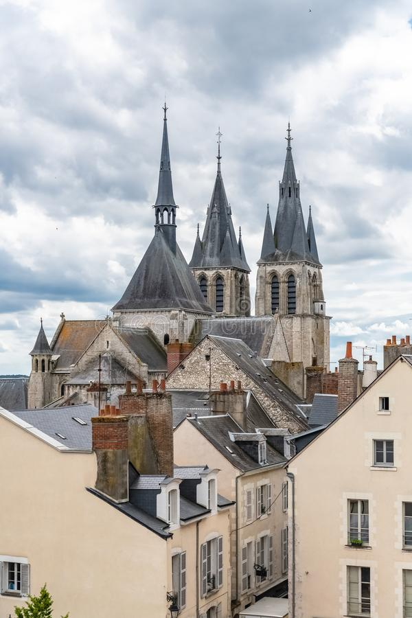 Blois in France, the Saint-Nicolas-Saint-Lomer church. And view of typical roofs of the ancient city royalty free stock photo