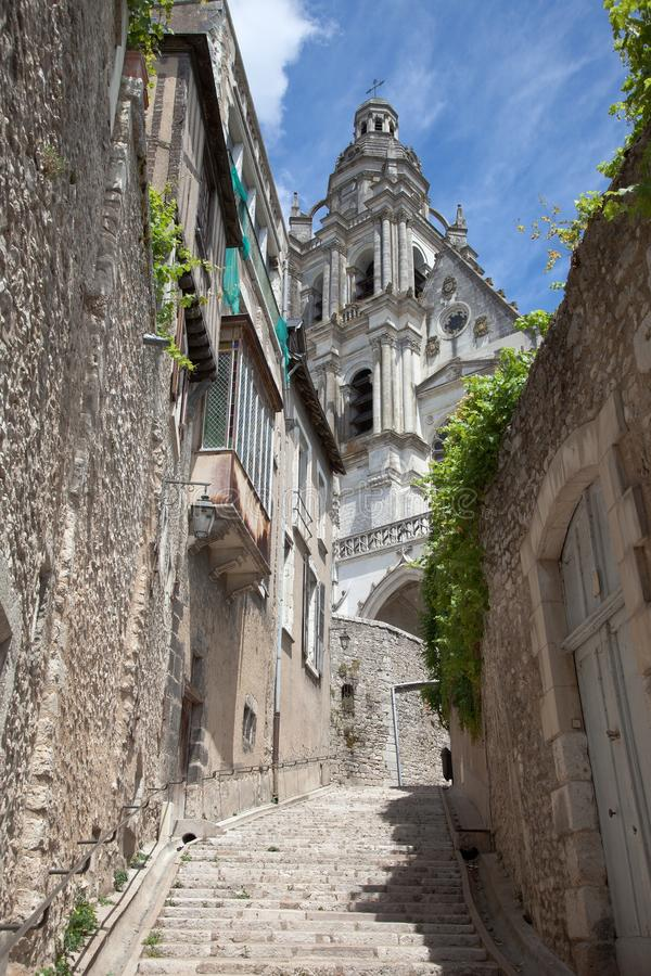 Blois France street scene. Street scene in a historic alley in Blois France. Blois Cathedral in the background royalty free stock photography