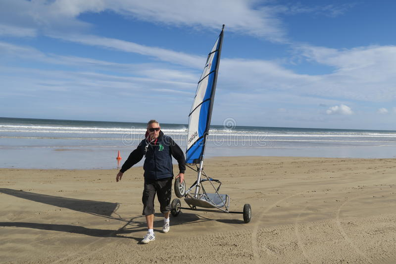 Blokart. A small cart with a sail that you can steer along the beach on three wheels. blokart has developed into a culture with an international community of royalty free stock image