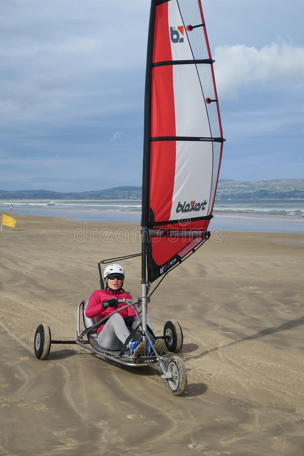 Blokart. A small cart with a sail that you can steer along the beach on three wheels. blokart has developed into a culture with an international community of royalty free stock photo