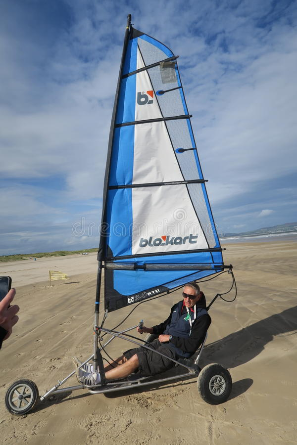 Blokart. A small cart with a sail that you can steer along the beach on three wheels. blokart has developed into a culture with an international community of stock images