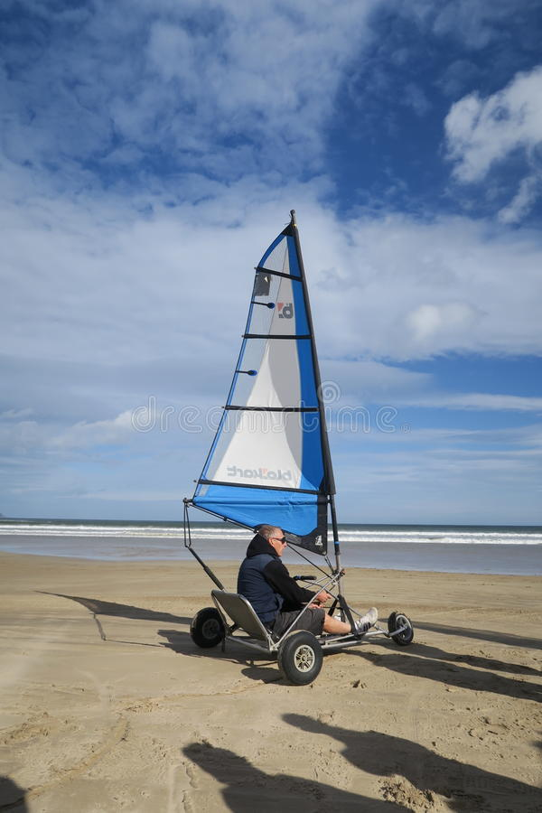 Blokart. A small cart with a sail that you can steer along the beach on three wheels. blokart has developed into a culture with an international community of stock photo