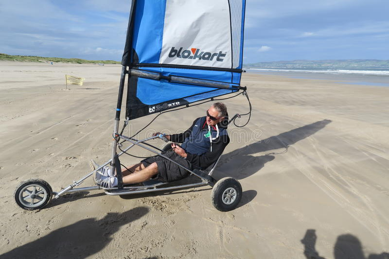Blokart. A small cart with a sail that you can steer along the beach on three wheels. blokart has developed into a culture with an international community of stock photography