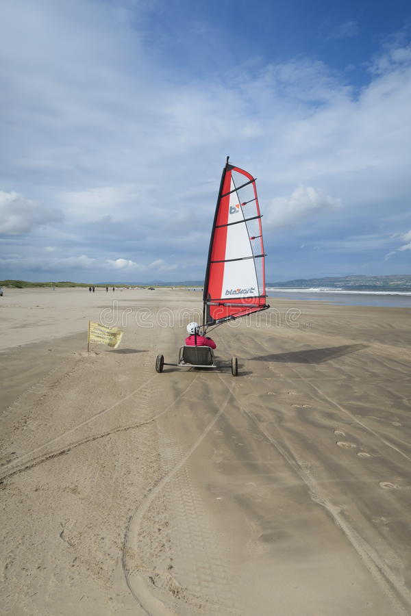 Blokart. A small cart with a sail that you can steer along the beach on three wheels. blokart has developed into a culture with an international community of stock image