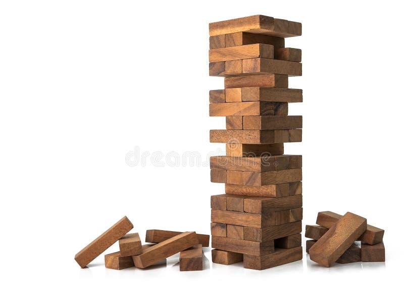 Blokuje drewnianą jenga grę odizolowywającą na białym tle obraz royalty free