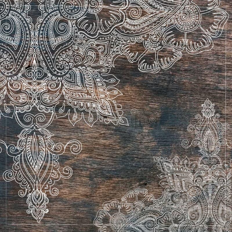 Blom- östlig prydnad för tappning på gammal wood textur arkivfoto