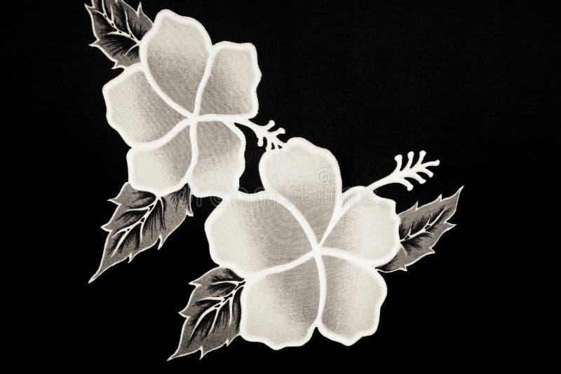 Blom- batiktextil arkivbild