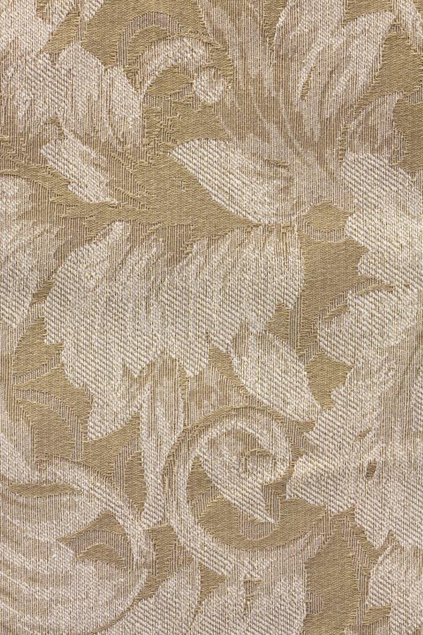 blom- pattesignal för beige tyg arkivfoto