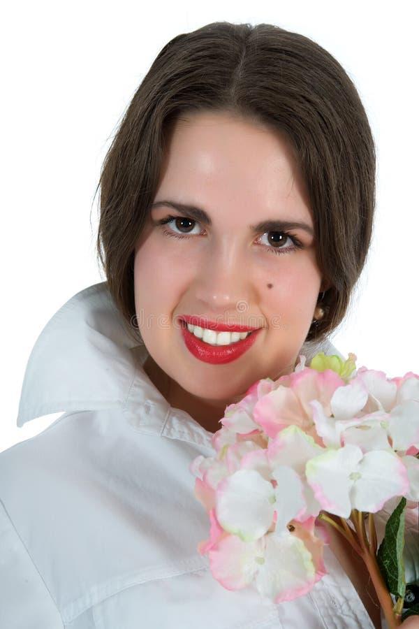 blommar den nätt kvinnan arkivfoto