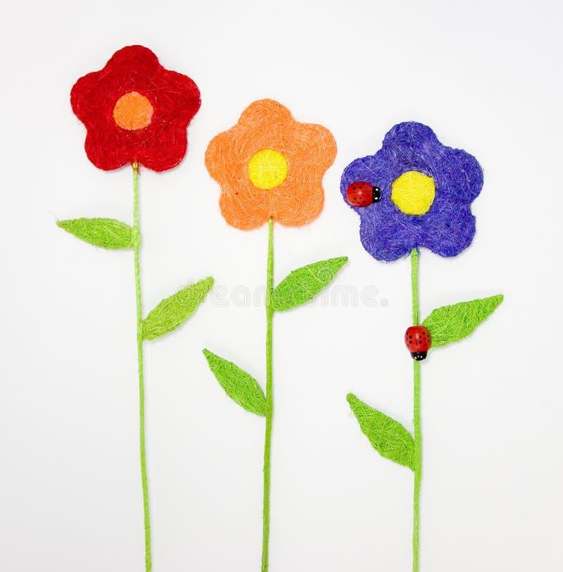 Blommor och nyckelpigor arkivbild
