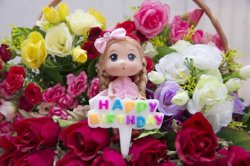 Blommor och välfyllt med en lycklig födelsedag för emblem royaltyfri bild
