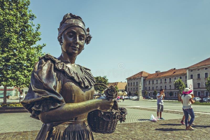 Blomsterhandlare Woman Bronze Statue arkivbild