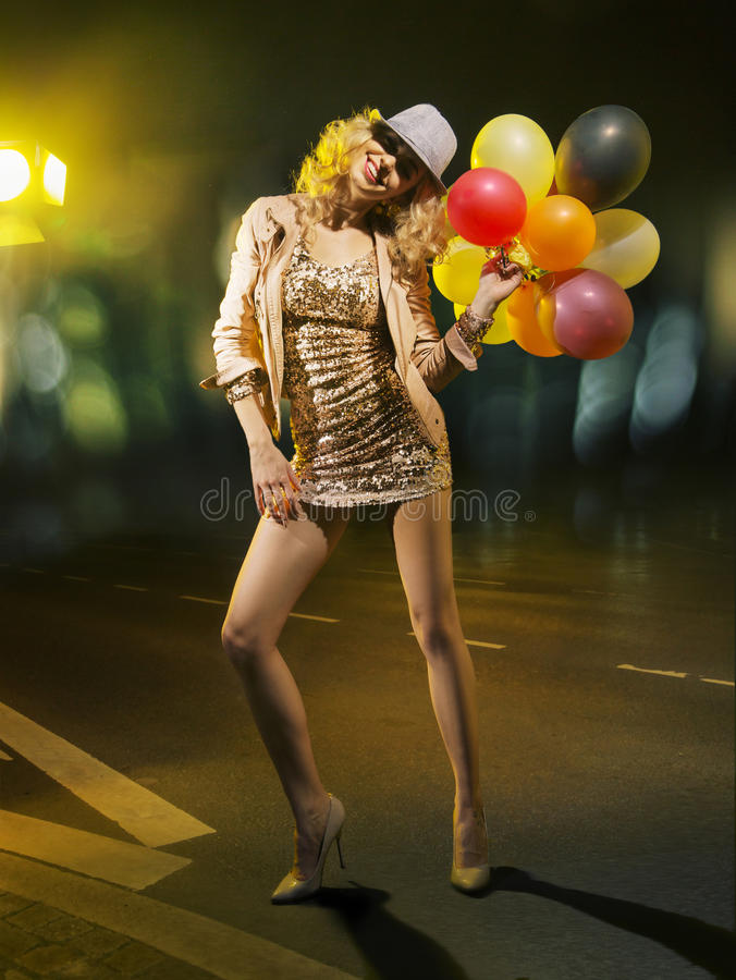 Blond alluring woman with balloons. Blond alluring lady with balloons royalty free stock photo