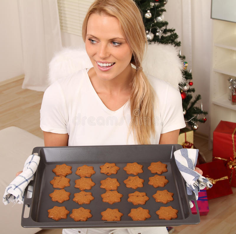 Download Blond angel with cookies stock photo. Image of home, xmas - 16439990