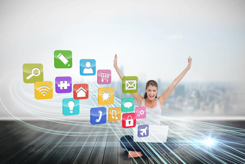 Blond användande bärbar dator för bifall med app-symboler arkivbilder