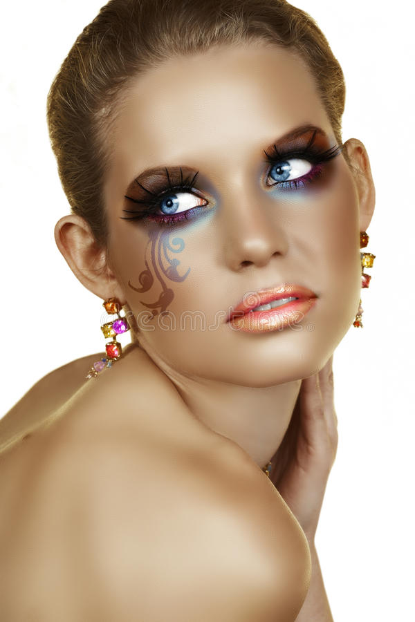 Blond with artistic make-up. royalty free stock images