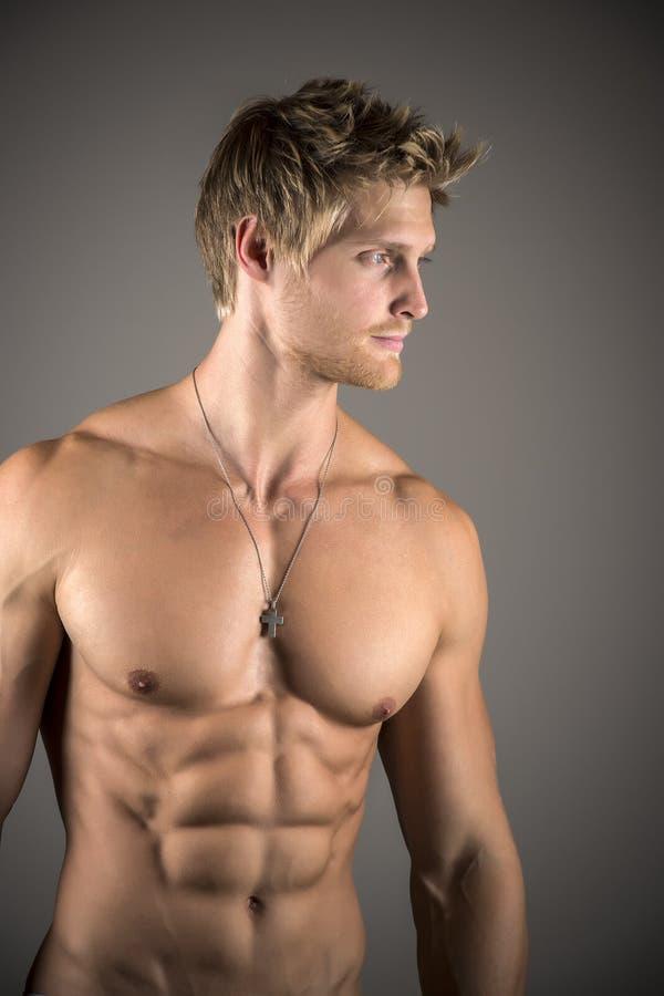 Blond athetic man royaltyfri foto