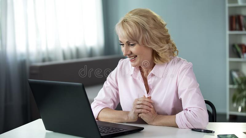 Blond attractive woman chatting with man online, date application, leisure. Stock photo royalty free stock photo
