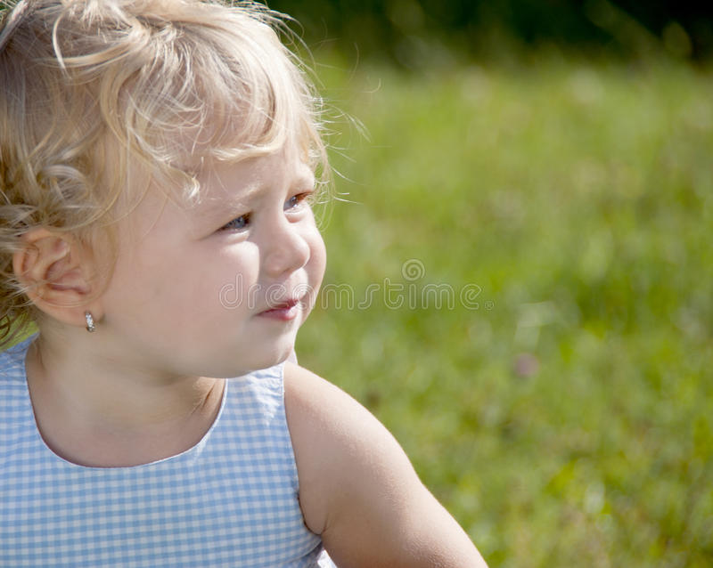 Blond baby girl stock image