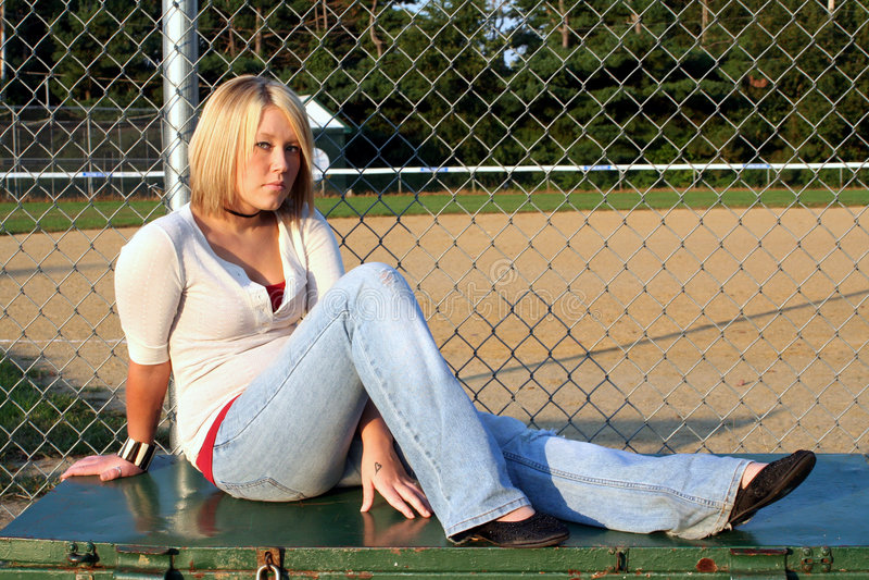 Blond At Baseball Field 2 royalty free stock photography