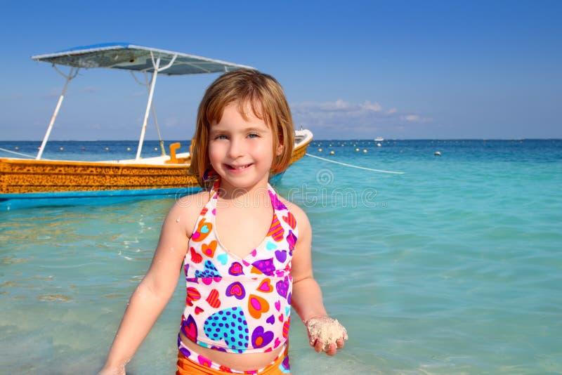 Blond beach little girl Caribbean vacation stock image