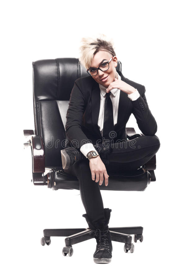 Blond beautiful business lady in white shirt eyeglasses black su. It and black tie sit on chair stock images