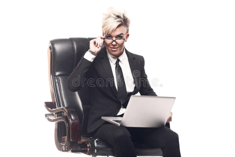 Blond beautiful business lady in white shirt eyeglasses black su. It and black tie sit on chair royalty free stock photos