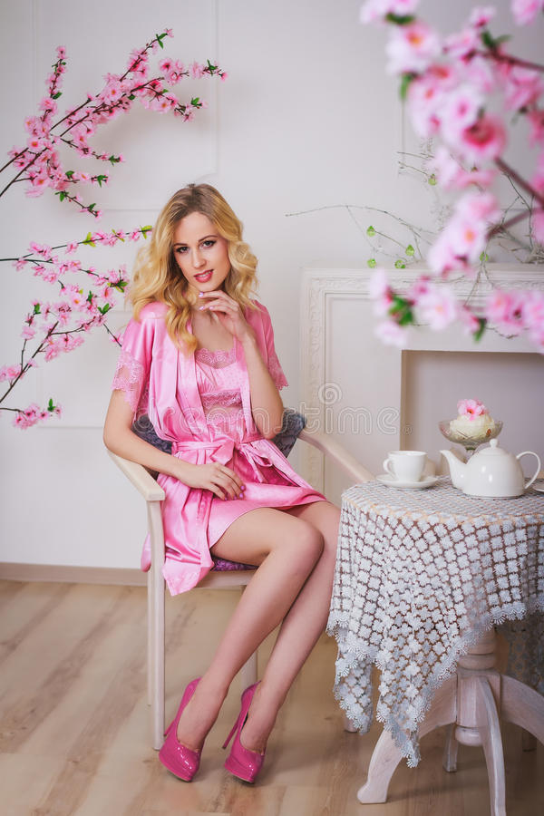 Blond Beautiful Woman In Pink Dressing Gown Stock Image - Image of ...