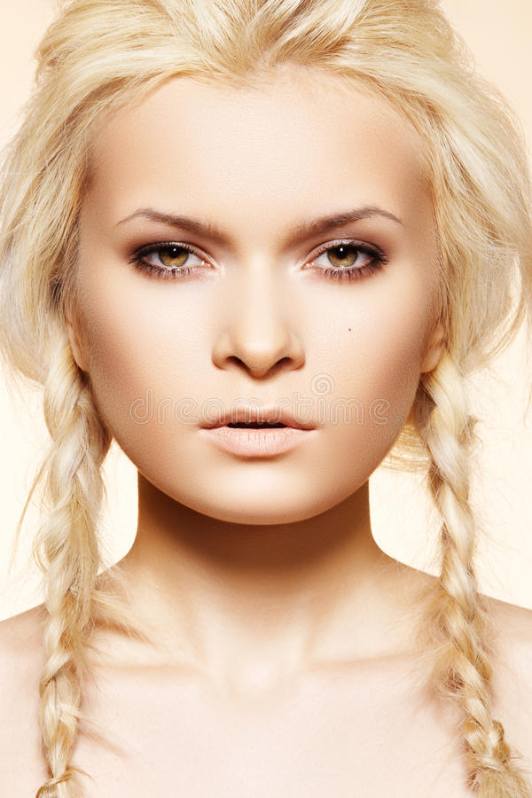 Blond beauty with hippie fashion hairstyle, braids. Wellness, cosmetics and skincare. Beautiful woman model with delicate natural make-up, clean skin, fashion stock photo