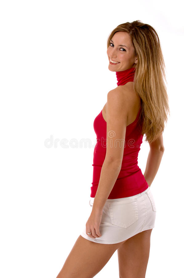 Blond beauty in mini skirt isolated on white royalty free stock image